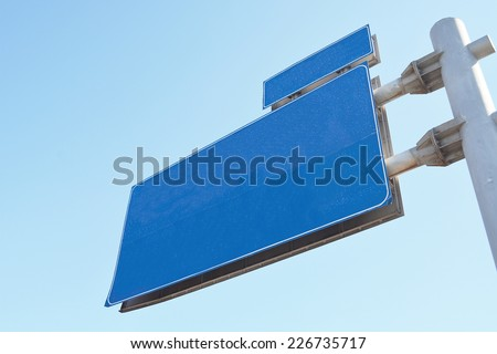 Blank Blue Road Sign,Large White Frame,bottom view - stock photo