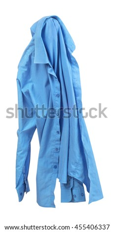 Blank blue shirt are falling through the air on an isolated white background. - stock photo