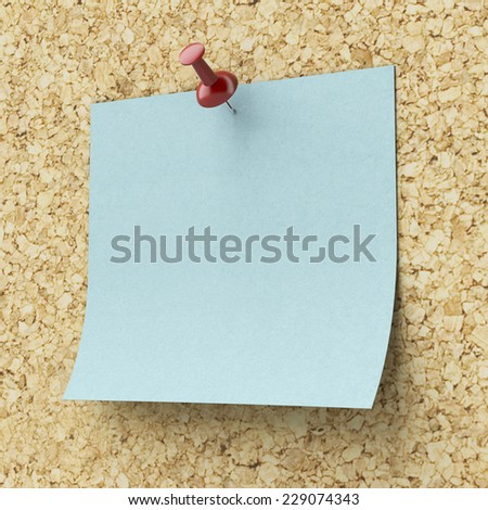 Blank blue sticky note pinned on a cork board - stock photo
