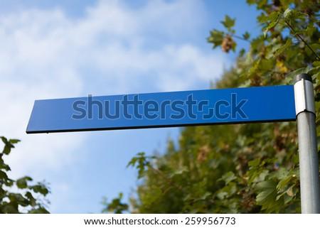 Blank blue street sign. - stock photo