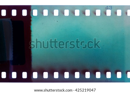 Blank blue vibrant noisy film strip texture background - stock photo