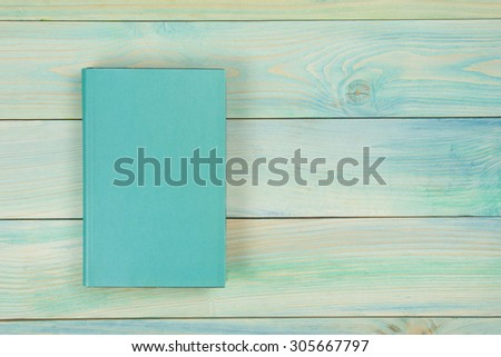 Blank book cover on textured wood background. Copy space - stock photo