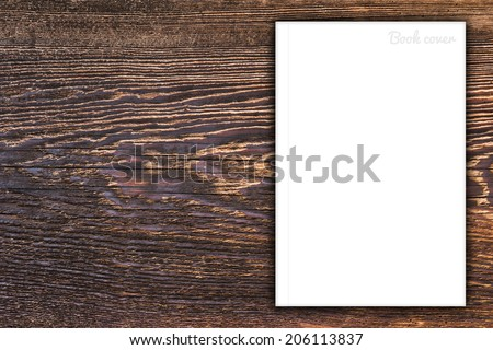 Blank book or magazine cover on wood background - stock photo