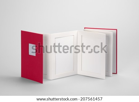 Blank book, photo album against a grey background with his shadow. Clipping path and path for each frame - stock photo