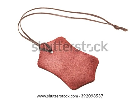 Blank brown leather tag isolated on white background - stock photo