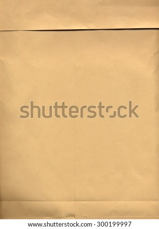 blank brown paper sheet useful as a background - stock photo