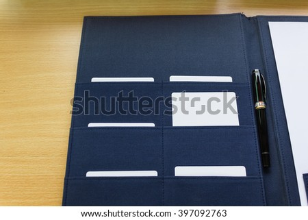 Blank business card in file folder selected, unique or important one choosing concept - stock photo