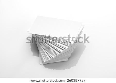 Blank Business Card Mockup on White Reflective Background - stock photo