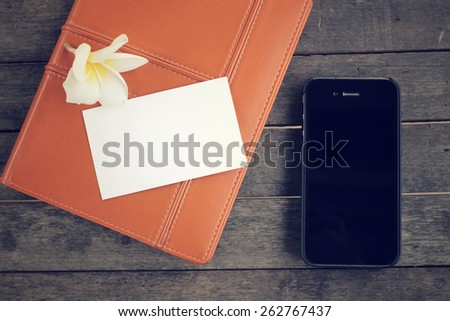 Blank business card with smart phone - stock photo