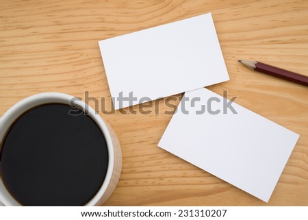 blank business cards and coffee and pencil on wooden table, good for text & logo - stock photo