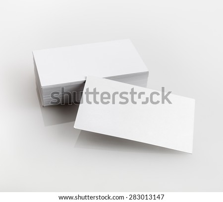 Blank business cards on a light gray background. Template for branding identity for designers portfolios. - stock photo
