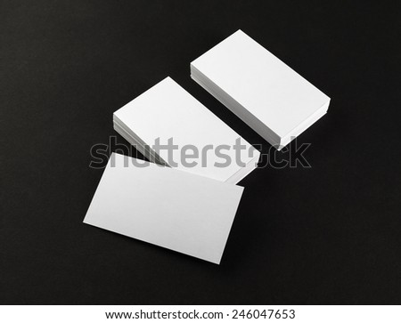 Blank business cards on black background. Template for branding identity. Clipping path. - stock photo