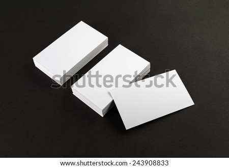 Blank business cards on black background. Template for ID. - stock photo