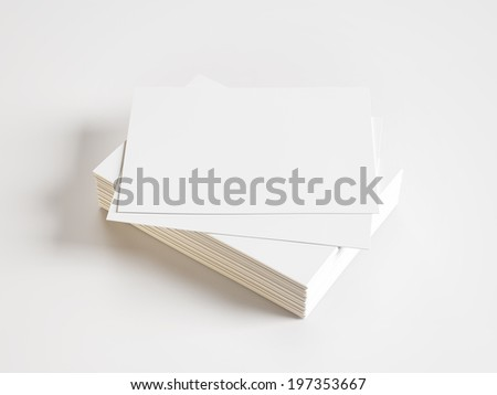 Blank business cards on white background - stock photo