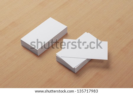 Blank Business Cards on wooden background with soft shadows - stock photo