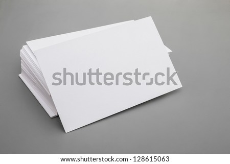 blank business cards stack up on grey background, good for text & logo - stock photo