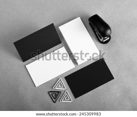 Blank business cards with clip and stapler on craft background. Identity design, corporate templates, company style - stock photo