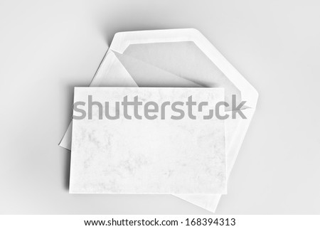 Blank card and envelope over grey background - stock photo