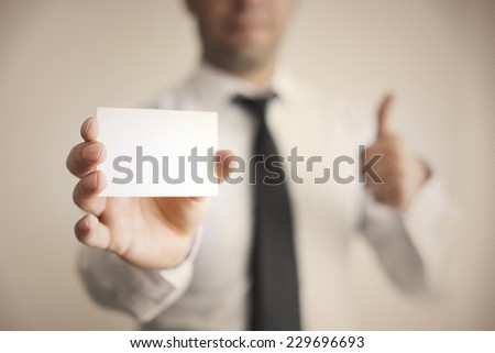 Blank Card holded by hand and thumbs up - stock photo