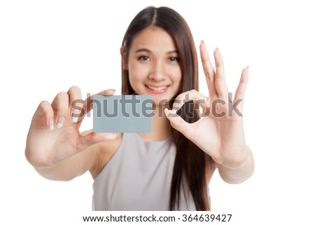 Blank card in beautiful young Asian woman hand  show OK sign isolated on white background - stock photo