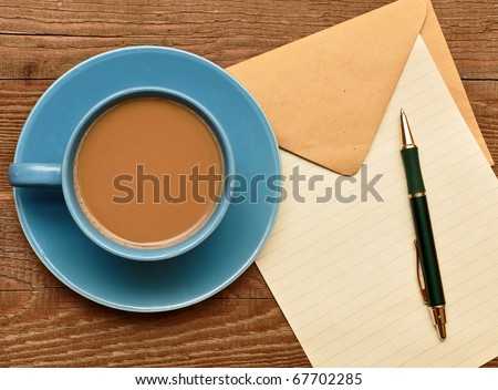 blank card on coffee cup with space for your text - stock photo