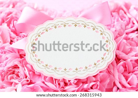 Blank card with pink bow ,beautiful pink carnations background - stock photo
