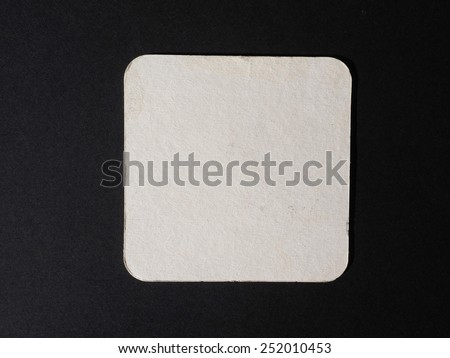 Blank cardboard beermat for a pint of beer - stock photo