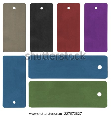 blank cardboard tags of different colors on white background - stock photo