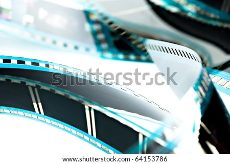 Blank celluloid cinema film strip isolated on white - stock photo