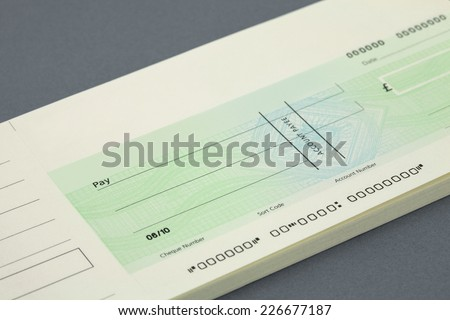 blank Cheque and cheque book - stock photo