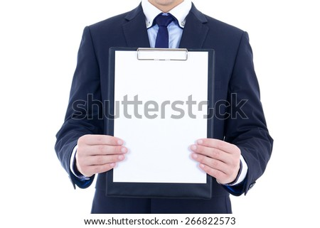 blank clipboard in young businessman's hands isolated on white background - stock photo