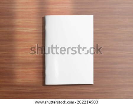 Blank closed brochure photo on wooden background to replace your design - stock photo