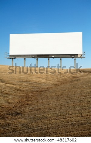 Blank commercial billboard outdoor on top of hill blue sky on background - stock photo