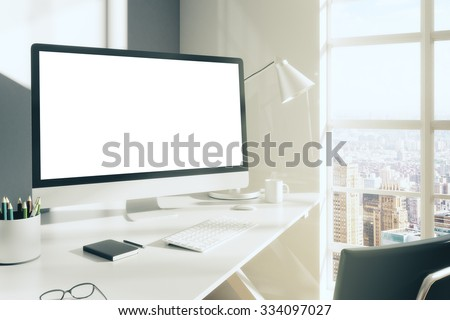 Blank computer desktop with keyboard, diary and other accesories on white table in sunny room, mock up - stock photo