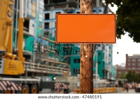 Blank construction sign on a electric wooden pole construction site on background - stock photo