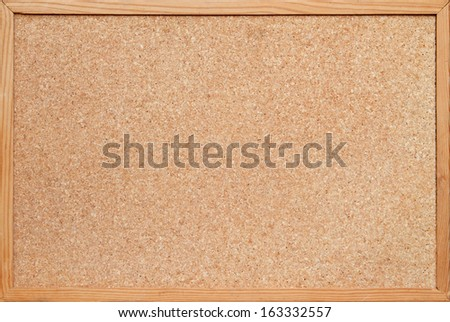 blank corkboard / bulletin board with a wooden frame - stock photo