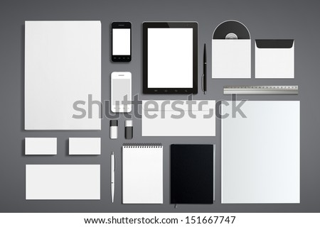 Blank Corporate ID Set isolated on grey. / Consist of Business cards, Folder, Tablet PC, envelopes, a4 letterheads, notebooks, flash, pencile, cd disk and smart phones. - stock photo