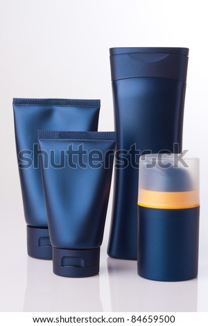 blank cosmetic tube and bottle on white - stock photo