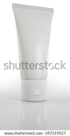 blank cream tube isolated on white background - stock photo