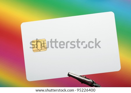 Blank credit card with colorful background - stock photo