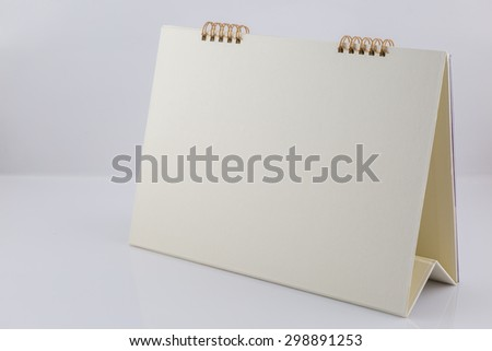 Blank desk calendar on white background - stock photo