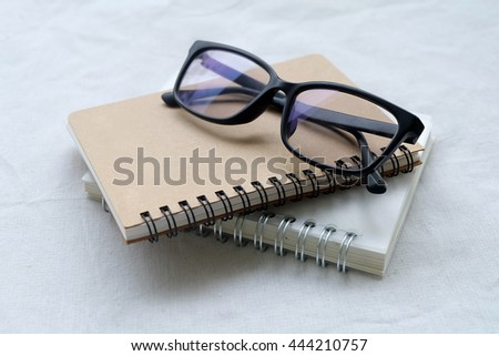 Blank diary, pen, and glasses on white background,rose  - stock photo