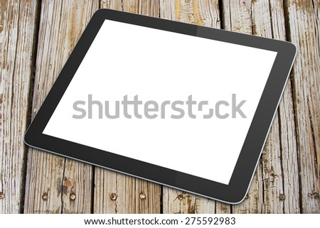 Blank digital tablet on a wooden table - stock photo