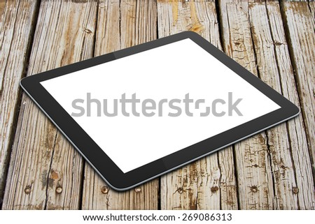 blank digital tablet on wooden table - stock photo