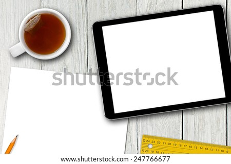 blank digital tablet, tea cup and paper sheet on wooden table - stock photo