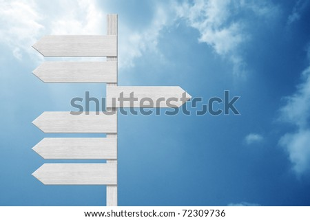 blank direction sign on the cloudy sky - stock photo