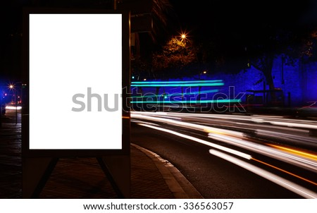 Blank electronic billboard with copy space for your text message or promotional content, public information board in the big city at night, clear poster with movement of cars on the background   - stock photo