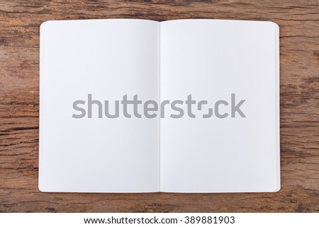 Blank empty notepad on wood background - stock photo