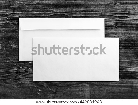 Blank envelopes on wooden background. Two envelopes. Back and front view. Mock-up for your design. For design portfolios. Top view. - stock photo