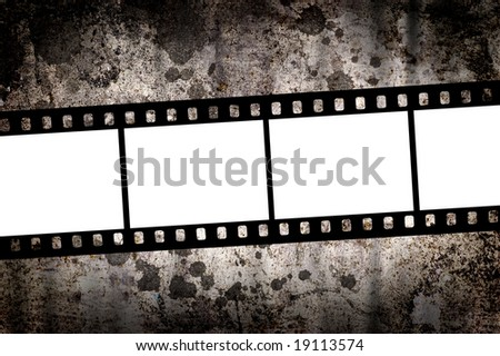 Blank film over a concrete wall - stock photo